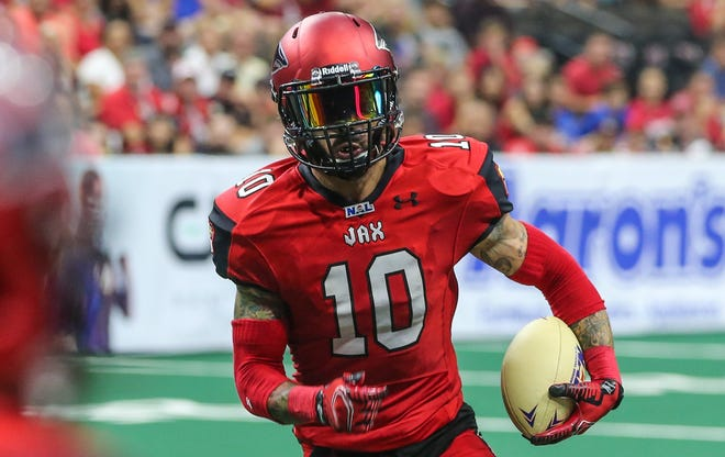 Jacksonville Sharks wide receiver Devin Wilson runs the ball during a National Arena League playoff game. Wilson is among several players returning for the Sharks, who kick off Saturday for the first time since 2019.