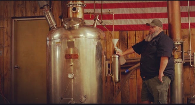 Lucas Owens is photographed at the South Mountain Distilling Co. in Connelly Springs, NC.