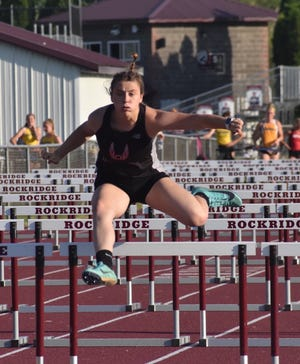 Orion's Delaney Taets clears the bar in the 100-meter hurdles at the Class 1A sectional track meet on Thursday, June 3, at Rockridge High School near Edgington.