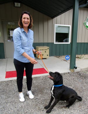 """Kim Park, board member of the Henry County Humane Society – Geneseo Shelter, is accompanied """"Rudy,"""" who has been at shelter for six months, on his journey to Midlothian, Texas, where he is being donated to Sector K9 Foundation for police K9 training."""