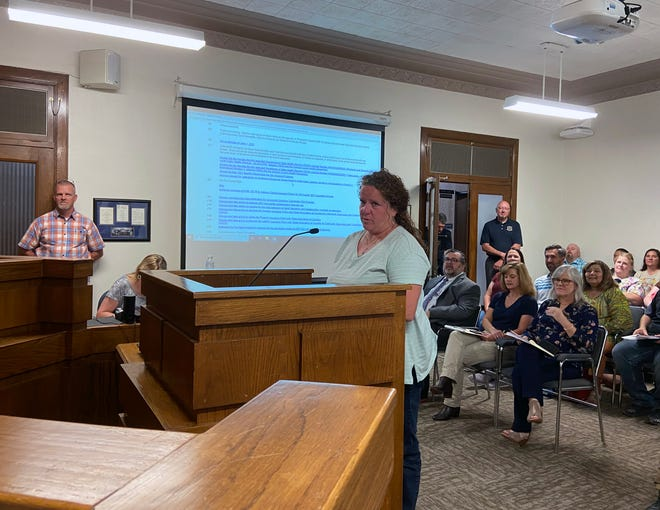 Workforce Solutions Texoma Representative Julie Baula speaks to commissioners Tuesday about the Business Education for Teachers program.