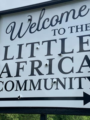 Little Africa's welcome sign was vandalized. Community members discovered the damage Tuesday.