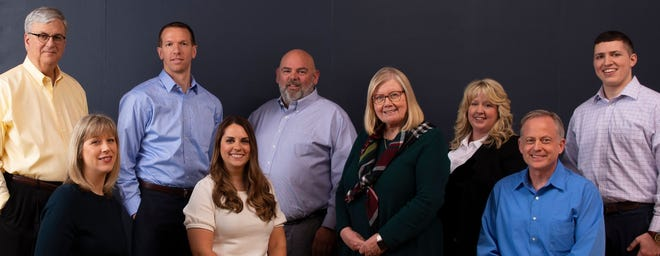 The team at Huizenga Gamache & Associates in downtown Holland.