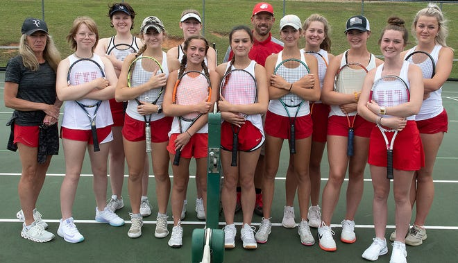 The 2021 Hendersonville High School girls tennis team poses after a match earlier this season.