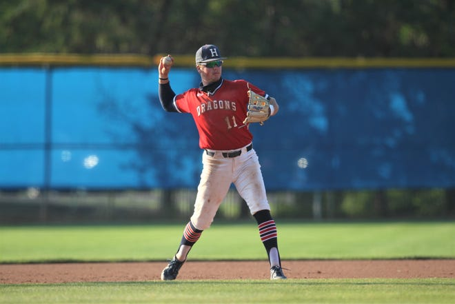 HCC infielder Austin Callahan makes a throw to first base during the Hutchinson sub-regional at Hobart-Detter Field.