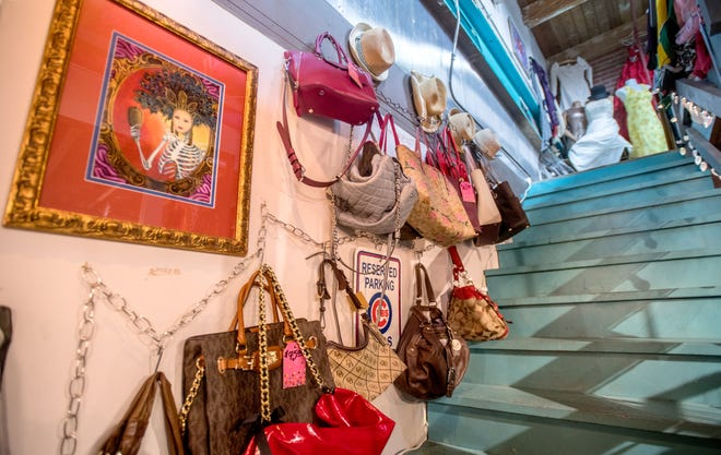Purses, hats and some artwork line the staircase to the second floor at Moxie's Resale Boutique in the Sunbeam Building.
