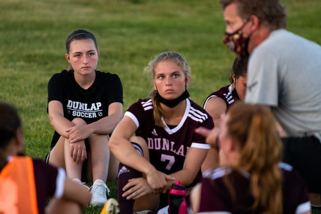 Tessa Sutton (back left) listens to Dunlap head coach Peter Cenek during halftime of Dunlap's 1-0 win over Washington at Dunlap Valley Middle School on Tuesday, June 8, 2021. Sutton, 15, was diagnosed with cancer in May and recently had a six day hospital stay.