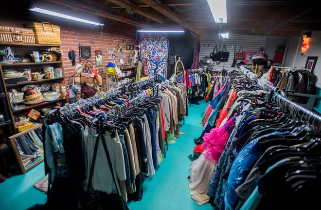 Racks of gently-used and vintage clothing and other fashion accessories fill the second floor of Moxie's Resale Boutique in the Sunbeam Building on Sheridan Road in Peoria.