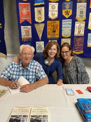 """George Whitfield, Frances Theodorakis and Bethany Bradsher pose for a photo after a Kinston rotary presentation. The book """"Covering all the Bases"""" features interviews Bradsher had with people that worked with Whitfield and he answered questions about baseball and his career."""
