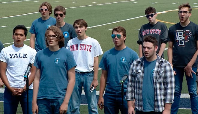 Members of the HHS Men's Choir perform at the HHSMemorial Stadium in the Spring Choirs Concert & Awards, airing on HCTV.
