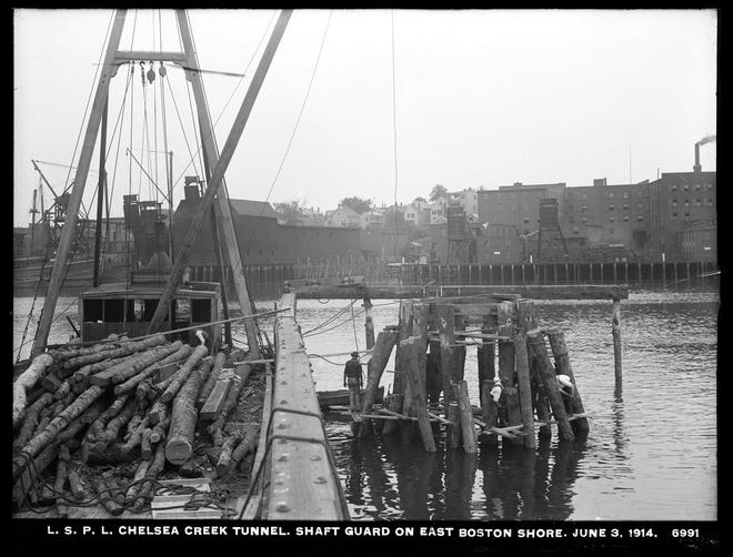Workers were busy with the low service pipe lines at the Chelsea Creek Tunnel in East Boston on June 3, 1914.