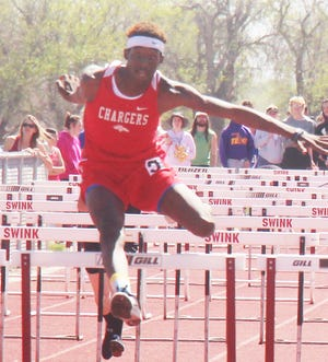Crowley County High School's Rashaun McNeil clears the final obstacle in the 110-meter high hurdles at the Ray Headley Invitational in Swink last month. McNeil is ranked in four events in the latest MaxPreps track and field rankings.