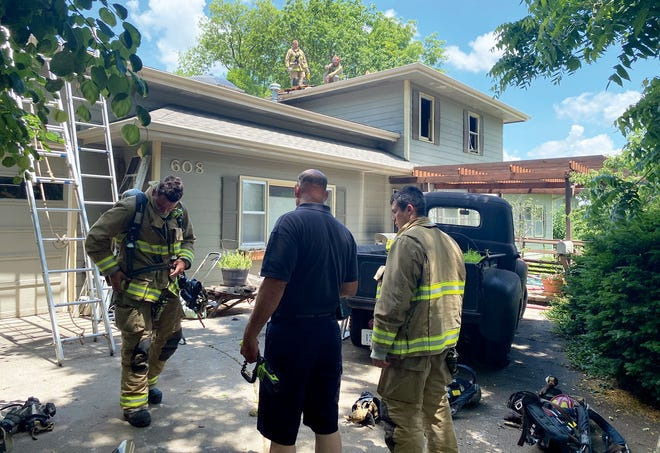 Members of the Leavenworth Fire Department remain on the scene of a fire Tuesday at a duplex apartment in the 600 block of Ohio Street.