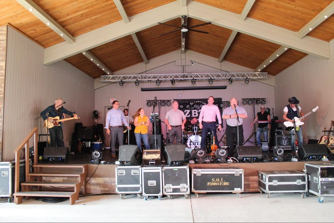 Supervisor Bill Reilich and members of the Greece Town Board introduce the Zac Brown Tribute Band to kick off the Summer Concert Series at Town Hall. The show was held in conjunction with the Jerry J. Helfer Memorial Food Truck Rodeo, which raised funds for an annual scholarship.