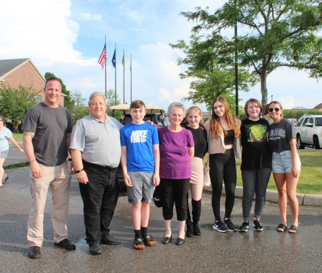 Supervisor Bill Reilich and members of Jerry Helfer's family attend the Jerry J. Helfer Memorial Food Truck Rodeo, hosted by the Greece Youth Board in conjunction with the Summer Concert Series at Town Hall.