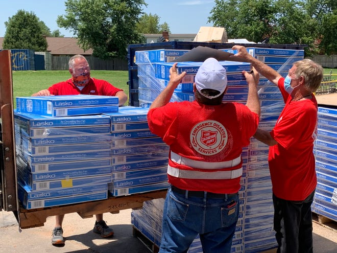 Westlake Ace Hardware store employees along with volunteers associated with The Salvation Army unload boxes of floor fans that were purchased through donations made by store customers. Westlake Ace's annual fan drive is taking place now through June 20 with all proceeds going towards the purchase of fans,. These fans will be given to persons in need through local Salvation Army Units that serve communities where Westlake's 121 stores are located, including Moberly.