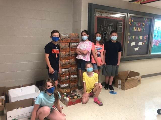 Students at Barnes Elementary School (from left) Lexi Stapula, Jordan Godfrey, Morgan Bolling, Vanessa Neace, Cynthia Tracy and Braeden Scott were among the volunteers who collected food for a school drive June 2-3 to benefit the Helping Hands ministry at Community Lutheran Church.