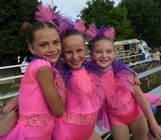 """Brookelyne Cartwright, 9, Mackenzie Cline, 8, and Adalynn Rios, 8, pose for a photo as they wait for the Viva Dance Co. second show to start at the Monroe County Fairgrounds. The girls were going to dance to """"I Want Candy."""""""