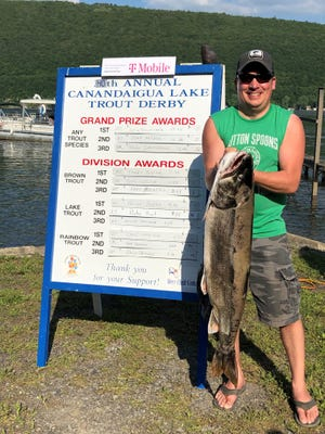 Justin Schwenzer of Dansville set a record with his 29.25-pound lake trout, the largest fish ever caught for the Canandaigua Lake Trout Derby.