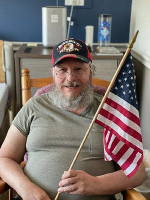 U.S. Marines veteran and Rochester native Bernie Boudrias, 63, remembers his fallen brothers and sisters on Memorial Day at the Ontario Center in Canandaigua.