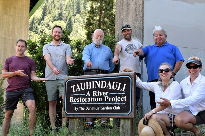 Because of one motivated citizen, the self-guided tour trail in Tauhindauli Park in Dunsmuir is getting upgrades and improvements. Together, Dunsmuir City Manager Todd Juhasz, Dunsmuir Mayor Matthew Bryan, Rotarian Representative Will Newman, Dunsmuir Public Works employee, and High School Boardmember Brian Wilson, Dunsmuir Parks and Recreation District Administrator Mike Rodriguez, Dunsmuir City Clerk Wendy Perkins along with Allison Leshefsky, a Dunsmuir resident who applied for a grant and put this project together, all point to the park's sign where their collaborative improvement project will benefit visitors and the Dunsmuir community.