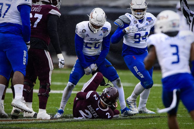 Former Tulsa cornerback Akayleb Evans, top middle, announced his graduate transfer decision Friday night. Pictured, Evans celebrates a sack of Mississippi State quarterback Will Rogers in 2020.