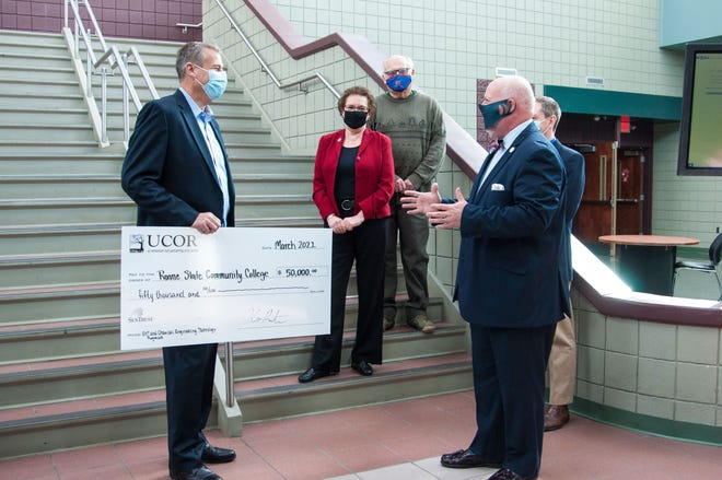 UCOR and Roane State representatives celebrate the $50,000 donation that will be used for a new apprenticeship effort and to purchase equipment for the college's chemical engineering technology laboratory. From left are UCOR Administrative Services Manager Charles Malarkey; Roane State Community College Chemical Engineering Technology Program Director Laura A. Hofman; Dan Hyder, Roane State Community College Interim Dean for Social Science, Business and Education Director, Environmental Health Technology Program; and Roane State Community College President Chris Whaley.
