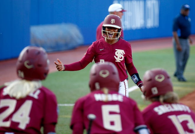 Florida State celebrates Kalei Harding's home run in the third inning during the first game of Women's College World Series championship series between University of Oklahoma (OU) and Florida State University at the USA Softball Hall of Fame Stadium in Oklahoma City, Tuesday, June 8, 2021.