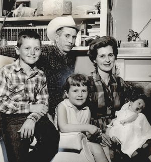 """Jim Shoulders is pictured with his wife, Sharon, and three of their children, Marvin Paul, Jana Lee and Marcia Marie, in June 1961 at their home on the J Lazy S ranch in Henryetta. Not pictured was their oldest daughter, Jamie, who was attending a rodeo. Shoulders and his family were featured in the sports section of The Daily Oklahoman while he was between rodeos. The headline read, """"Shoulders Real Cowboy, Not Drug Store Variety."""" The 33-year-old was already considered a living legend on the rodeo circuit. Shoulders died in 2007. Sharon Shoulders died earlier this year on Jan. 30."""