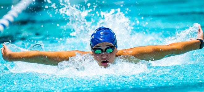 University of Florida Swimmer, and former Forest Wildcat, Elise Bauer practices the butterfly at the College of Central Florida Pool Wednesday afternoon. Bauer is competing in the USA Olympic Trials in Omaha, Nebraska in the 800 and 1500.