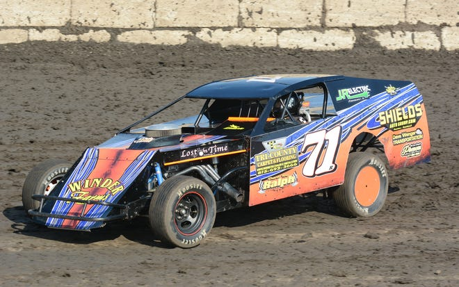 The modified of Troy Ricketts in preliminary action at Fairbury Speedway.