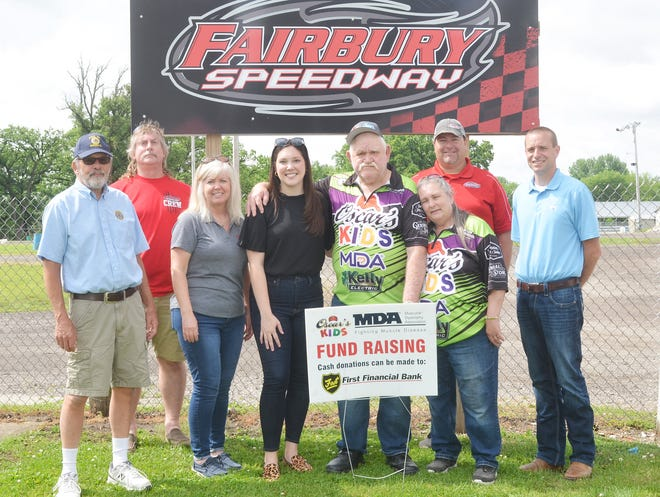Oscar Gorbet provided Muscular Dystrophy Association another big check recently at Fairbury Speedway. At the presentation were, from left, Gerry Brandt (Fairbury American Legion), Scott Runyon (Fairbury Speedway staff), Julie Moore (ReMax/Rising), Kelsey Tomko (Development Director MDA), Gorbet, Laura Gorbet, Matt Curl (owner and promoter at Fairbury Speedway) and Dustin Smith (First National Bank).