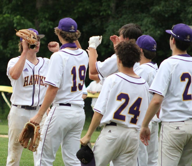 Marshwood relief pitcher Reed Smaracko (left) is congratulated by his teammates after Smaracko completed a two-inning save in Marshwood's 7-5 victory over Berwick Academy in a Class A South preliminary round game on Tuesday at Marshwood.