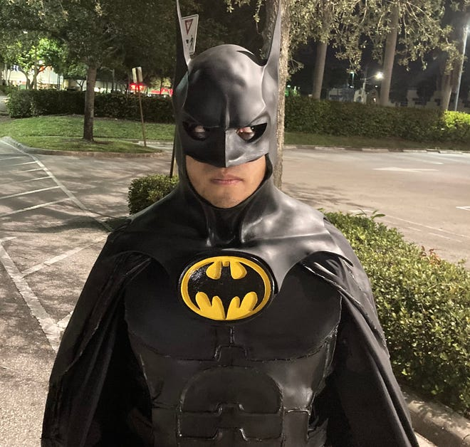 A 22-year-old Boynton Beach man dressed as Batman has been patrolling the city's streets for 10 months.