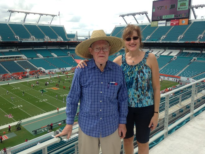 Dr. Spencer Meckstroth and Janet Meckstroth Alessi at a football game  at The University of Miami in October 2015. The trip was a gift for her football-loving dad on his 86th birthday.