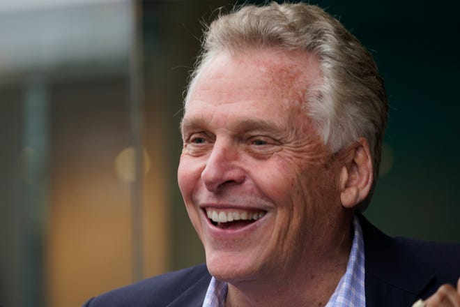 Democratic gubernatorial candidate, former Gov. Terry McAuliffe, greets supporters during a tour of downtown Petersburg, Va., Saturday, May 29, 2021. McAuliffe defeated four other Democrats in the primary June 8. (AP Photo/Steve Helber)