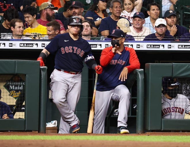 Red Sox manager Alex Cora, right, talks with catcher Christian Vazquez during a game last week against the Houston Astros at Minute Maid Park.