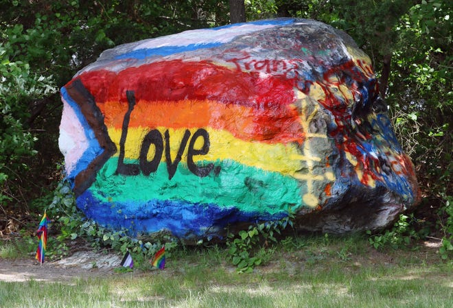Students painted the boulder outside East Greenwich High School in Pride colors last week and had to paint it again Sunday after somebody or some people had painted on their work.