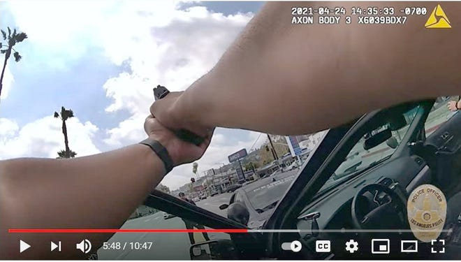 A frame grab from a police body-cam video shows Richard B. Solitro Jr., 34, bottom-center, confronting patrolmen on Sunset Boulevard, Los Angeles, on April 24.