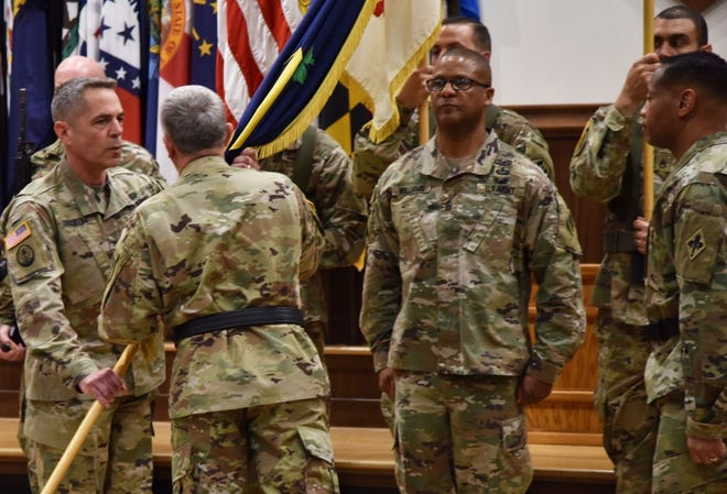 Col. Sean Crockett (left) accepts the U.S. Army Chemical, Biological, Radiological and Nuclear School colors from Maj. Gen. James Bonner, Maneuver Support Center of Excellence and Fort Leonard Wood commanding general, during a change-of-commandant ceremony June 4 in Lincoln Hall Auditorium, as outgoing commandant, Brig. Gen. Daryl Hood (right), and Regimental Command Sgt. Maj. Christopher Williams look on. Crockett assumes the role as the 32nd USACBRNS commandant, previously having served here as the USACBRNS assistant commandant, as well as 3rd Chemical Brigade commander. (Photo by Spc. Jayde Shooks, USACBRNS)