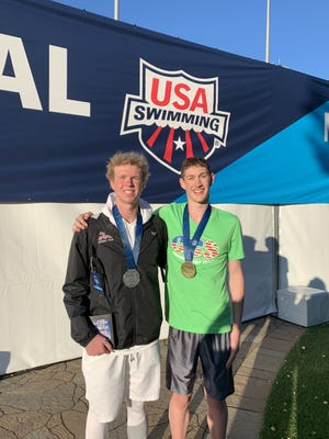 Chris O'Connor (left) and Hunter Armstrong (left) at the USA Swimming 2019 Junior Nationals