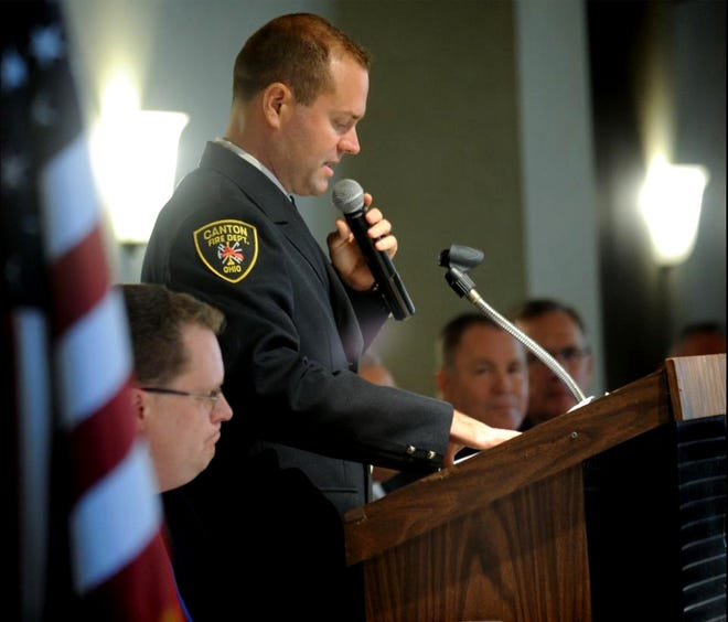 Canton firefighter/paramedic Justin Deierling accepts the Firefighter of the Year award during the 52nd annual Fire Prevention Week kickoff breakfast in October 2017.