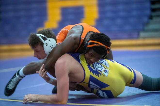 Freeport's Markel Baker, shown taking down Hononegah's Damien Huber during a regular season match in June in Roscoe, won the IWCOA state championship on Friday in Springfield.