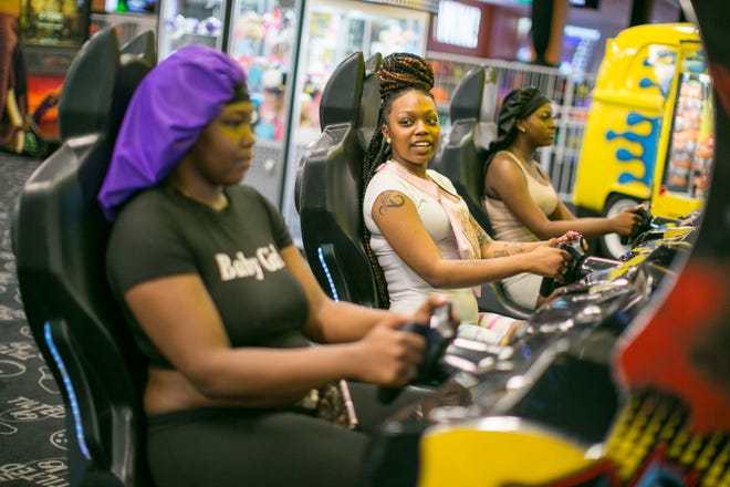 Gamers like Nia Ford, from right, Cora Woods and Charrie Graham, all from Rockford, enjoy the early afternoon Wednesday, June 9, 2021, at Tilted 10 at CherryVale Mall in Cherry Valley. State officials are set to remove COVID-19 pandemic restrictions on Friday.
