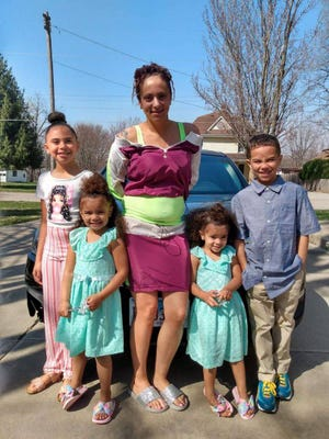 Jordan Thomas is surrounded by her three daughters Audrina, 9; KaMari, 3; and ZaMari, 2; and son, Antonio, 8. Thomas was fatally shot May 29 at a house party near 19th Street and Alton Avenue.