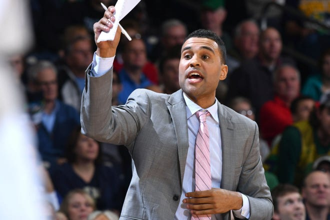 Former Notre Dame assistant men's basketball coach Ryan Ayers is charged with voyeurism, domestic battery and conversion.