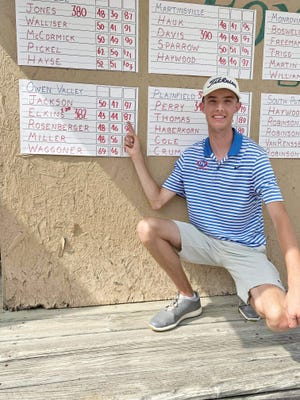 OV's Mason Elkins smiles as he points to his score, good enough for a playoff that ultimately moved him on to today's golf regional.