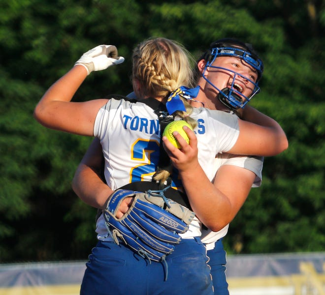 Catcher Emma Farley celebrates with pitcher Daleny Chumbley follow Buffalo Tri-City's 3-1, 10-inning, Class 2A, Sectional 6 semifinal at Quincy on Tuesday. The Tornadoes advanced to play Sacred Heart-Griffin in the title game on Thursday.
