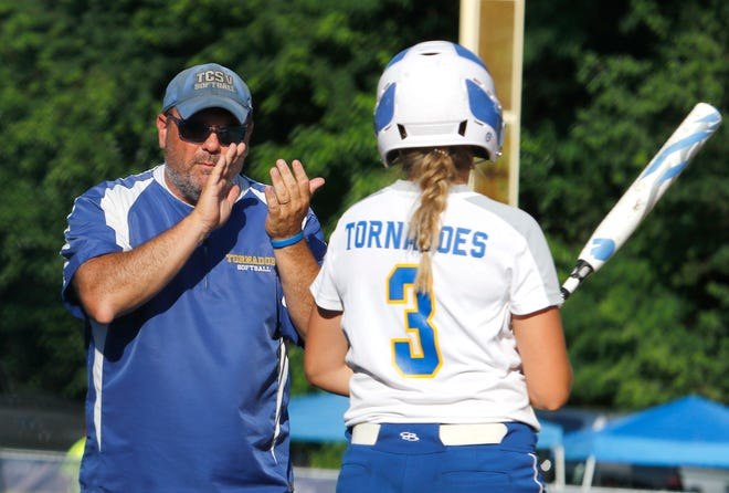 Buffalo Tri-City softball coach Brad Sturdy encourages the Tornadoes' Kenzie Krider during a 3-1, 10-inning win over Quincy Notre Dame in a Class 2A Sectional 6 semifinal game on Tuesday in Quincy.