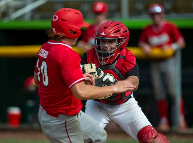 Springfield's Case Sparks (4) tags out Jacksonville's Drew Ezard (10) at home plate in the first inning during the Class 3A Regional Finals at Robin Roberts Stadium in Springfield on June 8. [Justin L. Fowler/The State Journal-Register]